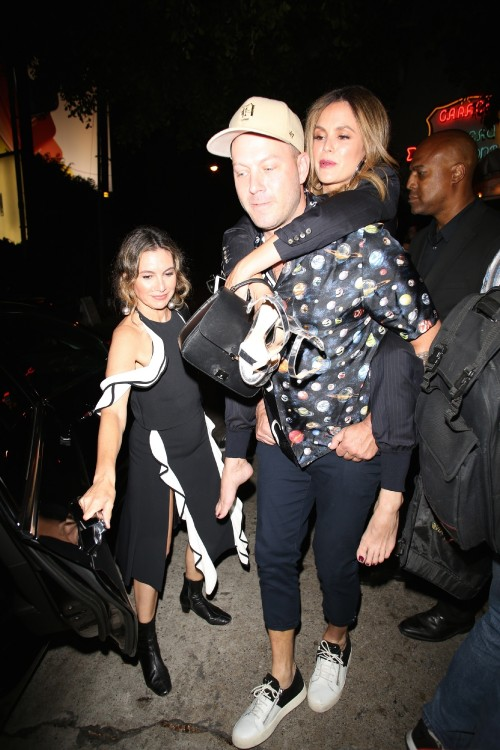 Los Angeles, CA  - Rachel Bilson gets a piggy ride from a friend outside of the Chateau Marmont.Pict